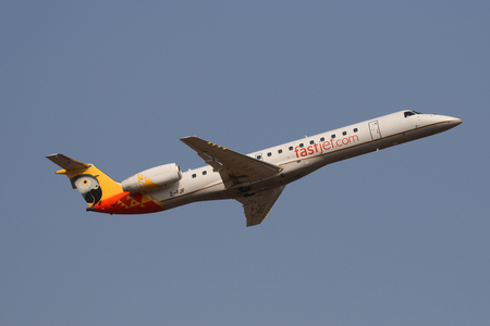 JOHANNESBURG, SOUTH AFRICA - SEPTEMBER 27, 2018: FastJet Zimbabwe Embraer ERJ-145LR takes off from O. R. Tambo International Airport in Johannesburg, South Africa Editorial