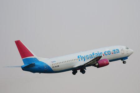 JOHANNESBURG, SOUTH AFRICA - SEPTEMBER 27, 2018: FlySafair Boeing 737 takes off from O. R. Tambo International Airport in Johannesburg, South Africa