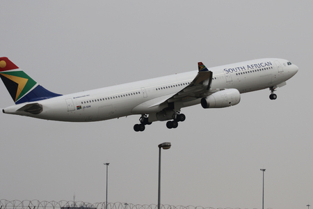 JOHANNESBURG, SOUTH AFRICA - SEPTEMBER 27, 2018: South African Airways Airbus A330 takes off from O. R. Tambo International Airport in Johannesburg, South Africa