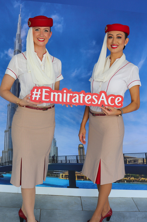 NEW YORK - SEPTEMBER 6, 2018: Emirates Airlines flight attendants at the Emirates Airlines booth during 2018 US Open at the Billie Jean King National Tennis Center in New York 報道画像