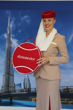 NEW YORK - SEPTEMBER 6, 2018: Emirates Airlines flight attendants at the Emirates Airlines booth during 2018 US Open at the Billie Jean King National Tennis Center in New York Redactioneel