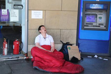 EDINBURGH, SCOTLAND - JULY 7, 2018: Homeless man in Edinburgh, Scotland