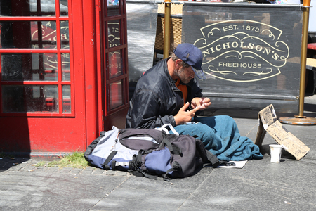 EDINBURGH, SCOTLAND - JULY 7, 2018: Homeless man in Edinburgh, Scotland
