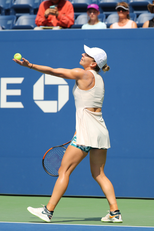 NEW YORK - AUGUST 27, 2018: Grand Slam Champion  Simona Halep of Romania in action during her 2018 US Open first round match at Billie Jean King National Tennis Center in New York Editorial