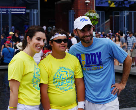 NEW YORK - SEPTEMBER 1, 2018: Buddy Up Tennis volunteers with Athletes at the 2018 US Open. Buddy Up Tennis exists to serve individuals with Down syndrome the opportunity to learn the sport of tennis