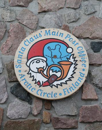 ROVANIEMI, FINLAND - FEBRUARY 19, 2017: The logo of Santa Claus' Main Post Office in the Santa Claus Village in Rovaniemi in the Lapland region of Finland. Редакционное