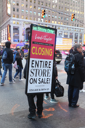 NEW YORK - NOVEMBER 29, 2018: Man wearing a sandwich board about Lord & Taylor 5th Avenue store closing at Times Square in Manhattan