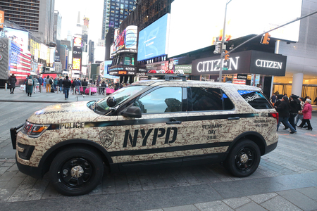 NEW YORK CITY - NOVEMBER 28, 2018 : NYPD Veterans Day 2018 car at Times Square. The New York City Police Department, established in 1845, is the largest municipal police force in the United States Editorial