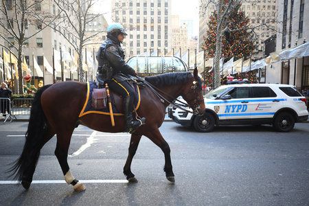 NEW YORK - NOVEMBER 29, 2018: NYPD Mounted Unit police officer provides security at Rockefeller Plaza in Midtown Manhattan
