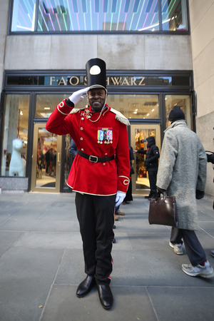 NEW YORK - NOVEMBER 29, 2018: A doorman dressed as a toy soldier stands outside newly reopened the FAO Schwarz flagship store at Rockefeller Plaza in Midtown Manhattan