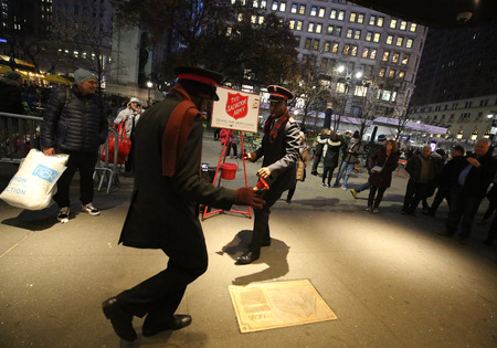 NEW YORK - DECEMBER 6, 2018: Salvation Army soldier performs for collections in midtown Manhattan. This Christian organization is known for its charity work, operating in 126 countries