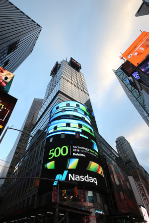 NEW YORK CITY - NOVEMBER 29, 2018: The headquarters of the NASDAQ Stock Exchange, the second largest trading market in the world in Times Square