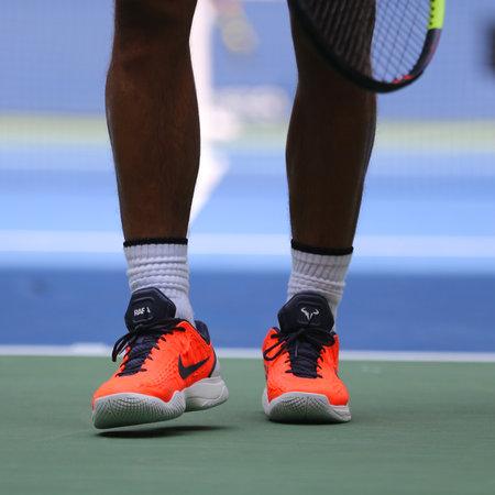 NEW YORK - AUGUST 26, 2018: Grand Slam champion Rafael Nadal of Spain wears custom Nike tennis shoes during US Open 2018 at Billie Jean King National Tennis Center in New York