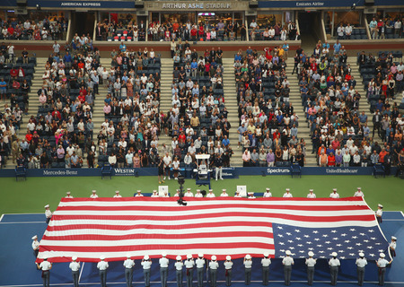 NEW YORK- SEPTEMBER 8, 2018: U.S. Military Academy at West Point cadets unfurling American Flag before the U.S. Open Mens Tennis Final match at Billie Jean King National Tennis Center