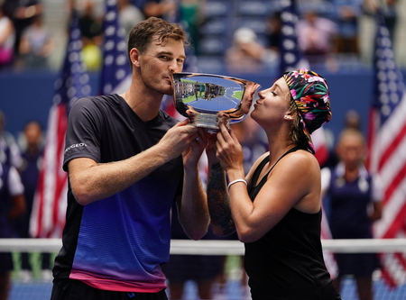 NEW YORK - SEPTEMBER 8, 2018: 2018 US Open mixed doubles champions Jamie Murray of Great Britain (L) and Bethanie Mattek-Sands of USA during trophy presentation after final match at National Tennis Center in NY