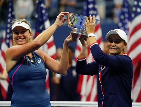 NEW YORK - SEPTEMBER 9, 2018: 2018 US Open women's doubles champions Ashleigh Barty of Australia (R) and CoCo Vandeweghe of USA during trophy presentation after final math at  National Tennis Center