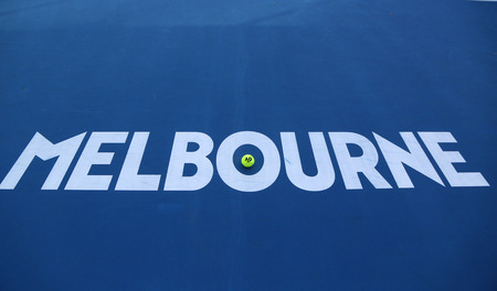 MELBOURNE, AUSTRALIA - JANUARY 23, 2019: Iconic Melbourne sign at Rod Laver Arena with Wilson tennis ball with Australian Open logo at Australian tennis center in Melbourne Park