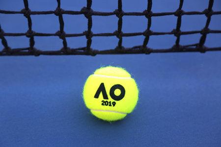 MELBOURNE, AUSTRALIA - JANUARY 23, 2019: Dunlop tennis ball with Australian Open logo on tennis court at Australian tennis center in Melbourne Park