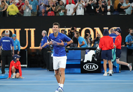 MELBOURNE, AUSTRALIA - JANUARY 25, 2019: 14 time Grand Slam Champion Novak Djokovic of Serbia celebrates victory after his semifinal match at 2019 Australian Open in Melbourne Park 新聞圖片