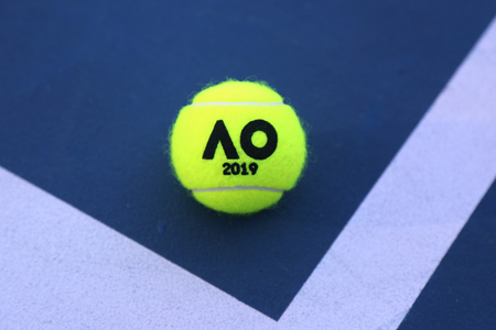 MELBOURNE, AUSTRALIA - JANUARY 23, 2019: Dunlop tennis ball with Australian Open logo on tennis court at Australian tennis center in Melbourne Park