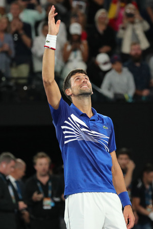 MELBOURNE, AUSTRALIA - JANUARY 27, 2019: 2019 Australian Open champion Novak Djokovic of Serbia celebrates victory after mens final match against Rafael Nadal of Spain at Rod Laver Arena in Melbourne Editorial
