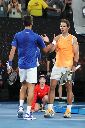 MELBOURNE, AUSTRALIA - JANUARY 27, 2019: Rafael Nadal of Spain (R) congratulates 2019 Australian Open champion Novak Djokovic with victory after men's final match in Melbourne Park