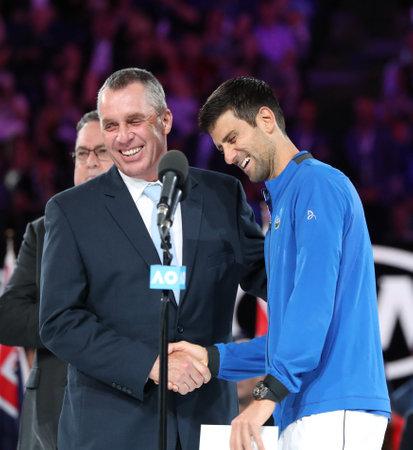 MELBOURNE, AUSTRALIA - JANUARY 27, 2019: Grand Slam Champion Ivan Lendl (L) congratulates 2019 Australian Open champion Novak Djokovic of Serbia during trophy presentation after mens final match Editorial