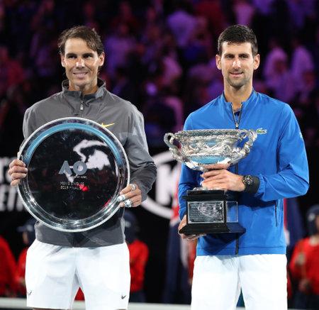 MELBOURNE, AUSTRALIA - JANUARY 27, 2019: Rafael Nadal of Spain (L) and 2019 Australian Open champion Novak Djokovic during trophy presentation after mens final match in Melbourne Park
