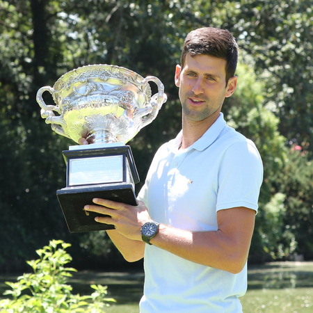 MELBOURNE, AUSTRALIA - JANUARY 28, 2019: 2019 Australian Open champion Novak Djokovic of Serbia posing with Australian Open trophy after his victory at Royal Botanic Gardens Victoria in Melbourne