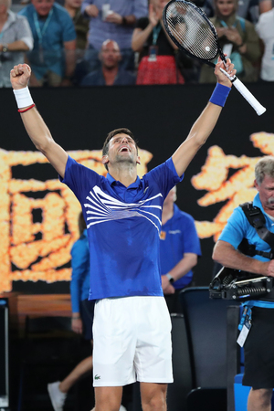 MELBOURNE, AUSTRALIA - JANUARY 25, 2019: 14 time Grand Slam Champion Novak Djokovic celebrates victory after his semifinal match at 2019 Australian Open in Melbourne Park
