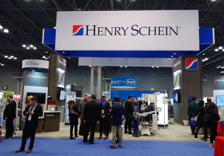 NEW YORK - NOVEMBER 27, 2018: Henry Schein booth during Greater New York Dental Meeting at Javits Center. Henry Schein is a distributor of health care products and services in 34 countries