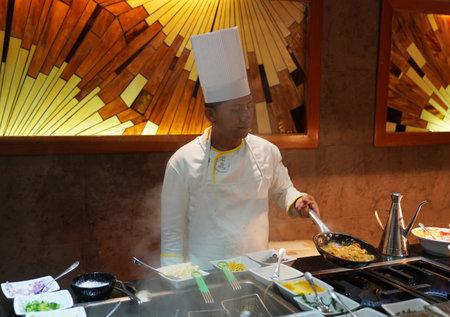 PLAYA DEL CARMEN, MEXICO - JANUARY 5, 2018: Cook preparing food at Iberostar Grand Hotel Paraiso at Playa Del Carmen, Mexico