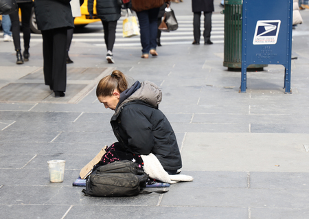 NEW YORK - MARCH 7, 2019: Homeless woman at 5th Avenue in Midtown Manhattan Editorial