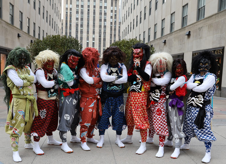 NEW YORK - MARCH 7, 2019: Unidentified Japanese tourists in national dress posing for pictures at Rockefeller Center in Midtown Manhattan