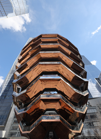 NEW YORK - MARCH 19, 2019: The Vessel, the centerpiece of the Public Square and Gardens at Hudson Yards, opened on Manhattan's West Side. The elaborate honeycomb-like structure rises 16 stories Editorial