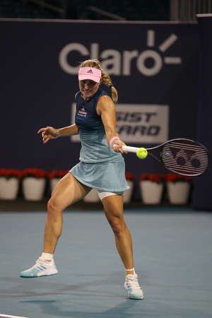 MIAMI GARDENS, FLORIDA - MARCH 23, 2019: Grand Slam champion Angelique Kerber of Germany in action during her round of 32 match at 2019 Miami Open at the Hard Rock Stadium in Miami Gardens, Florida