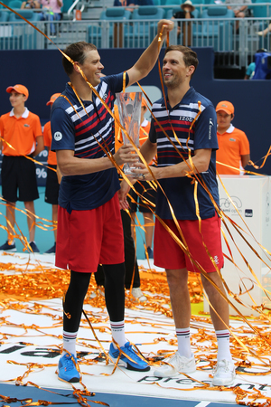 MIAMI GARDENS, FLORIDA - MARCH 27, 2019: 2019 Miami Open doubles Champions Mike and Bob Bryan of USA during trophy presentation at the Hard Rock Stadium in Miami Gardens, Florida