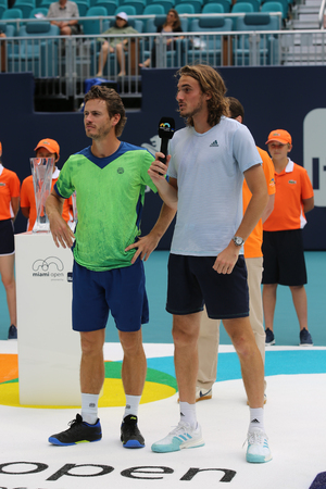 MIAMI GARDENS, FLORIDA - MARCH 27, 2019: 2019 Miami Open doubles finalists Wesley Koolhof (NED) and Stefanos Tsitsipas (GRC)  during trophy presentation at the Hard Rock Stadium in Miami Gardens, FL Editöryel