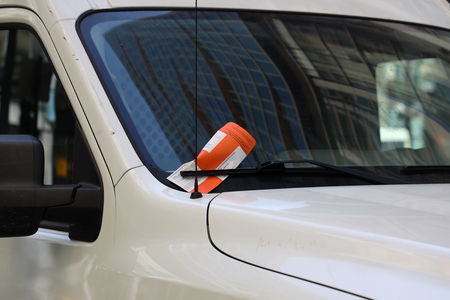 CHICAGO, ILLINOIS - MARCH 12, 2019: Illegal Parking Violation Citation On Car Windshield in Chicago
