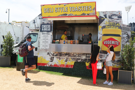 MELBOURNE, AUSTRALIA - JANUARY 27, 2019: Unidentified spectators like Deli Style Toasties with Vegemite during 2019 Australian Open in Melbourne Park