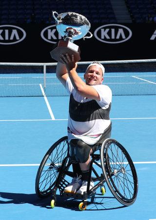 MELBOURNE, AUSTRALIA - JANUARY 27, 2019: Grand Slam champion Dylan Alcott of Australia during trophy presentation after 2019 Australian Open quad wheelchair singles final match at Rod Laver Arena