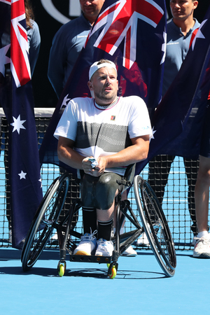 MELBOURNE, AUSTRALIA - JANUARY 27, 2019: Grand Slam champion Dylan Alcott of Australia during trophy presentation after 2019 Australian Open quad wheelchair singles final match at Rod Laver Arena