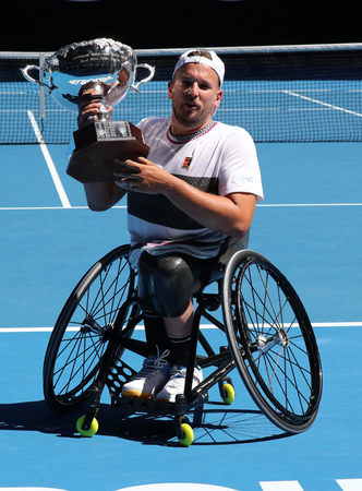 MELBOURNE, AUSTRALIA - JANUARY 27, 2019: Grand Slam champion Dylan Alcott of Australia during trophy presentation after 2019 Australian Open quad wheelchair singles final match at Rod Laver Arena Redactioneel