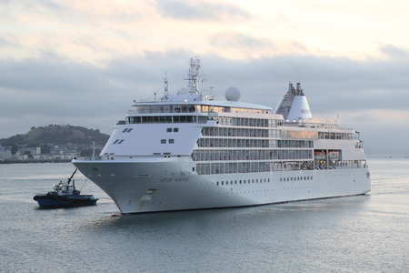 AUCKLAND, NEW ZEALAND - JANUARY 29, 2019: Silverseas Silver Whisper Cruise Ship in Auckland Harbor. Silver Whisper takes a Grand Voyage around the world during 2019 World Cruise