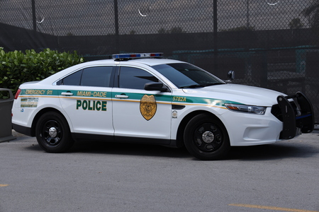 MIAMI, FLORIDA - MARCH 27, 2019: Miami - Dade police department car in South Miami. Police Department serving Miami-Dade County and has more than 3 thousand officers Standard-Bild - 122072262
