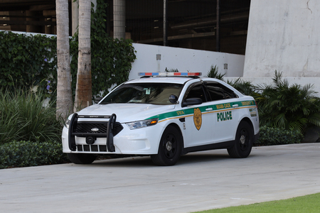 MIAMI, FLORIDA - MARCH 27, 2019: Miami - Dade police department car in South Miami. Police Department serving Miami-Dade County and has more than 3 thousand officers Standard-Bild - 122072265
