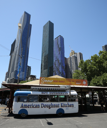 MELBOURNE, AUSTRALIA - JANUARY 24, 2019: American Doughnut Kitchen doughnut stand at Queen Victoria Market in Melbourne. It is a major landmark and  largest open air market in the Southern Hemisphere