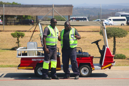 MPUMALANGA, SOUTH AFRICA - OCTOBER 2, 2018: Baggage handlers at the Kruger Mpumalanga International Airport in South Africa.