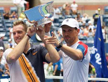 NEW YORK - SEPTEMBER 7, 2018: 2018 US Open men doubles champions Jack Sock (L) and Mike Bryan of United States during trophy presentation at the Billie Jean King National Tennis Center