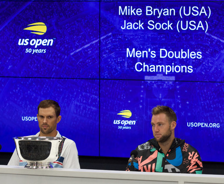 NEW YORK - SEPTEMBER 7, 2018: 2018 US Open men doubles champions Mike Bryan (L) and Jack Sock of United States during press conference after final match at the Billie Jean King National Tennis Center